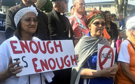People hold up posters during a demonstration against gender-based violence in Parow, Cape Town, on 15 September 2019. Picture: Shamiela Fisher/EWN.