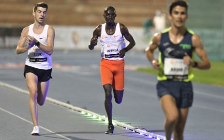 Ugandan athlete Joshua Cheptegei (C) competes in the men's 10,000m event during the NN Valencia World Record Day at the Turia stadium in Valencia on 7 October 2020. Cheptegei set a new men's 10,000m world record of 26 minutes 11 seconds in event. Picture: AFP