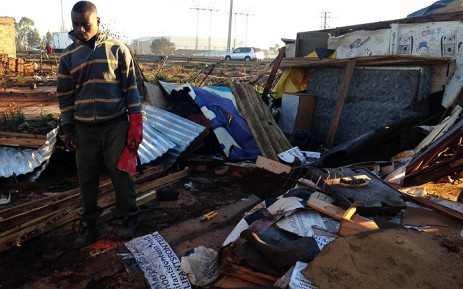 A man stands beside the ruins of a shack after a Tornado struck Tembisa on Tuesday 26 July 2016. Picture: Masego Rahlaga/EWN.