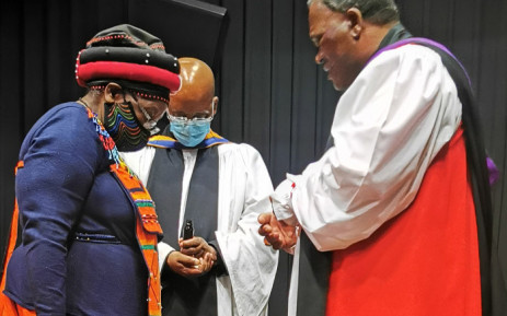 Bishop of Makhanda, Ebenezer Ntlali anoints Ntsiki Biko following the awarding of the Honorary Doctrate of Laws Degree by Rhodes University at the Steve Biko Centre. Picture: Steve Biko Foundation.