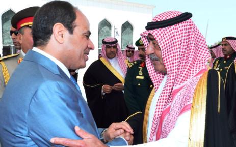 FILE: A handout picture shows Egypt's President Abdel Fattah al-Sisi (L) bidding farewell to Saudi Arabia's Deputy Prime Minister Prince Muqrin bin Abdulaziz al-Saud. Picture: AFP.