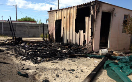 A house of a man who allegedly raped a three-year-old girl in Delft has been torched. Picture: Carmel Loggenberg/EWN