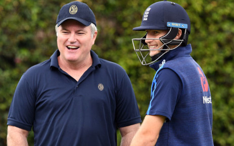 FILE: England captain Joe Root (R) chats with former Australian spinner Stuart MacGill (L) during training at the SCG in Sydney on 3 January 2018, a day ahead of the start of the fifth Ashes cricket Test match against Australia. Picture: William West/AFP
