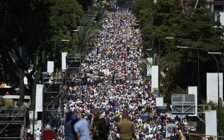 Opposition activists pour to the streets to back Venezuelan opposition leader Juan Guaido's calls for early elections, in Caracas on 2 February 2019. Tens of thousands of protesters were set to pour onto the streets of Caracas to back self-proclaimed acting president Guaido's calls for early elections as international pressure increased on President Nicolas Maduro to step down. Major European countries have set a Sunday deadline for Maduro to call snap presidential elections. Picture: AFP