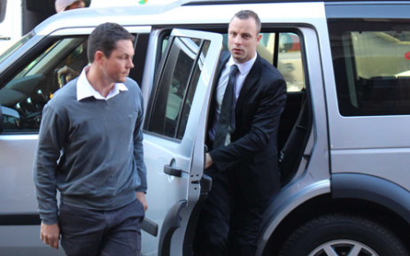 FILE: Oscar Pistorius enters the High Court in Pretoria ahead of his murder trial on 12 May 2014. Picture: Christa Eybers/EWN.