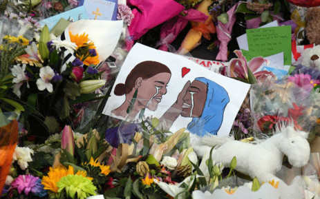 A poster at a memorial site for the victims of mosque attacks in Christchurch on 19 March 2019. Picture: AFP