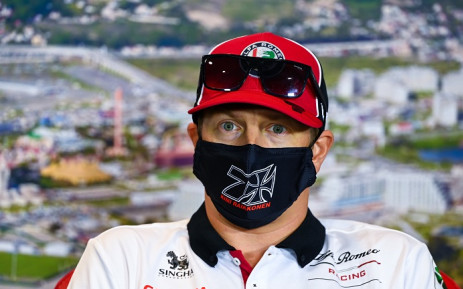 This handout photo taken on 24 September 2020 by the International Automobile Federation (FIA) shows Alfa Romeo's Finnish driver Kimi Raikkonen addressing the drivers' press conference for the Formula One Russian Grand Prix, at the Sochi Autodrom circuit in Sochi. Picture: AFP.