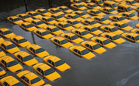 A parking lot with cabs in New Jersey is left flooded after Superstorm Sandy hit the area on 30 October 2012. Picture: Twitter