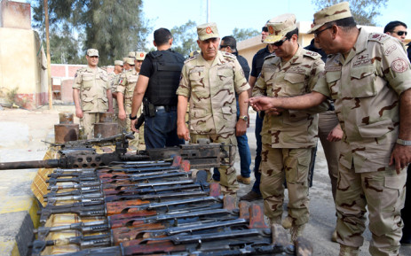 A handout picture released by the Egyptian Presidency on 4 July, 2015, shows Egyptian President Abdel Fattah al-Sisi (2nd from R) reviewing military equipment during a visit to the Sinai Peninsula following a wave of deadly attacks on armed forces by the Islamic State jihadists. Picture: AFP.