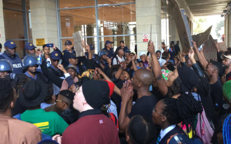 Protesters against gender-based violence clash with police at the Cape Town International Convention Centre on 4 September 2019.  Picture: EWN
