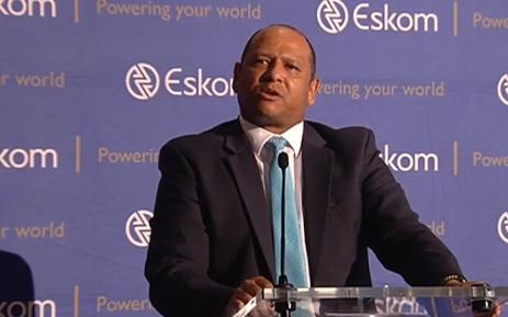 A YouTube screengrab shows Eskom chief financial officer Calib Cassim.