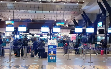 FILE: Passengers making their way to check-in points at OR Tambo International Airport for the first time since restrictions were eased under level 3 regulations for business travel. Picture: Bonga Dlulane/EWN.