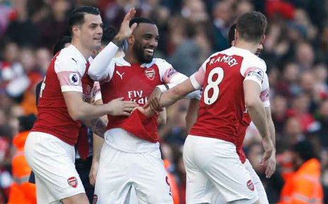 Arsenal's French striker Alexandre Lacazette celebrates with teammates after scoring during the English Premier League football match between Arsenal and Southampton at the Emirates Stadium in London on 24 February 2019. Picture: AFP