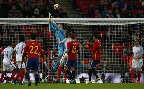 England's goalkeeper Tom Heaton (C) punches the ball away during the friendly international football match between England and Spain at Wembley Stadium, north-west London, on 15 November, 2016. The match ended in a draw at 2-2. Picture: AFP.