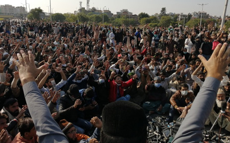 FILE: Activists and supporters of Tehreek-e-Labbaik Pakistan (TLP), a religious party, shout slogans during an anti-France demonstration in Islamabad on 16 November 2020. Picture: AFP