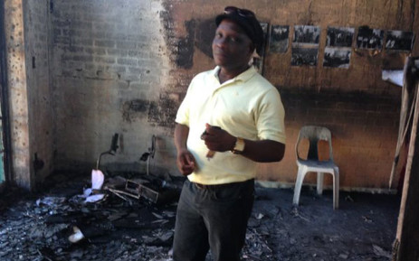Philippi ward councillor Mzuzile Mpondwana stands outside his office which was torched by four unknown men. Picture: Lauren Isaacs/EWN