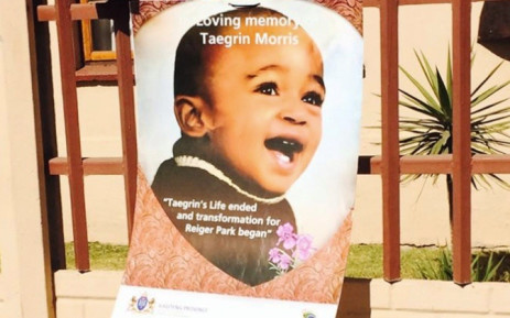 A photograph of Taegrin Morris is strung to a fence outside his home for a march in memory of the boy who was killed in a tragic hijacking, 25 July 2014. Picture: Dineo Bendile/EWN.