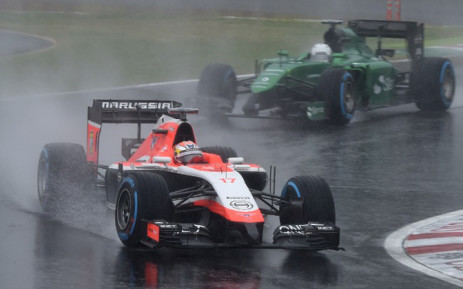 FILE:Marussia driver Jules Bianchi (front) of France leads Caterham driver Kamui Kobayashi of Japan at the Formula One Japanese Grand Prix in Suzuka on 5 October, 2014. Picture: AFP