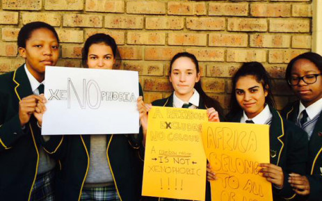 Students from Kingsmead College in Johannesburghold up anti-xenophobic placards. Picture: @Palie_Mogodi via Twitter