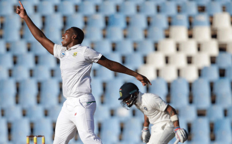 South African bowler Lungi Ngidi (L) celebrates the dismissal of Indian batsman and Captain Virat Kohli (R) during the fourth day of the second Test cricket match between South Africa and India at Supersport cricket ground on 16 January 2018 in Centurion. Picture: AFP