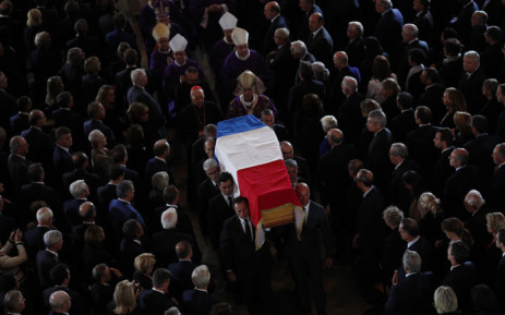 The coffin of the late French president Jacques Chirac is carried from the Saint Sulpice Church in the French capital Paris to a waiting hearse following his funeral service on 30 September 2019. Picture: AFP