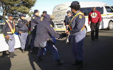 Police reinforcements were called after taxi operators started intimidating the officers. Picture: Thomas Holder/EWN.