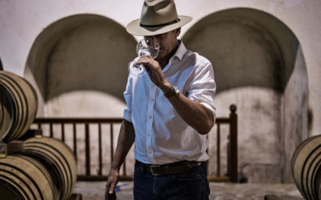 South African wine maker Anthony Hamilton Russell samples a young Chardonnay inside his barrel room at his 52 hectares wine farm in Hemel en Aarde, on 23 February 2021. Picture: MARCO LONGARI/AFP