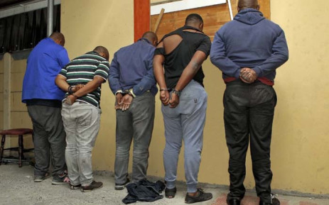 FILE: Five suspects in handcuffs following their arrest for possession of stolen vehicles and prohibited firearms at Bishop Lavis in Cape Town. Picture: SAPS
