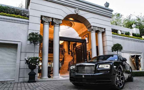 The ultimate freebie! This Rolls-Royce is all yours if you buy the Gatsby Mansion in Houghton. Picture: Chas Everitt