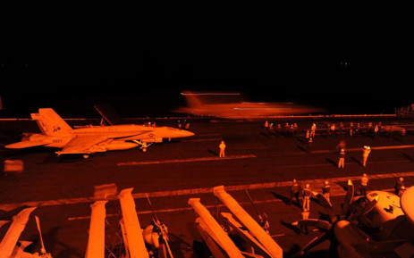 An F/A-18E Super Hornet attached to Strike Fighter Squadron (VFA) 31 and an F/A-18F Super Hornet attached to Strike Fighter Squadron (VFA) 213 prepare to launch from the flight deck of the aircraft carrier US. Picture: Official US Department of Defense Facebook.