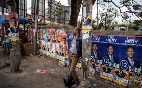 Electoral posters are seen at a bus stop in Antananarivo, on 6 November 2018, on the eve of in the first round of the presidential elections. Picture: AFP