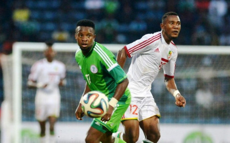 Congolese Thievy Bifouma (L) vies for the ball with Nigeria's Ogenyi Onazi during the 2015 African Cup of Nations qualifying football match between Nigeria and Congo Brazzaville on 6 September, 2014. Picture: AFP.