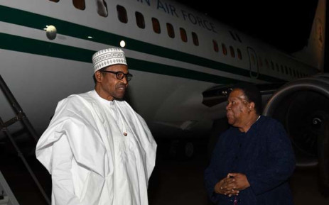 Nigerian President Muhammadu Buhari (L) arrives in South Africa on 2 October 2019 at Waterkloof Air Force Base in Tshwane for a state visit. Buhari was met by International Relations and Cooperation Minister Naledi Pandor. Picture: @DIRCO_ZA/Twitter.