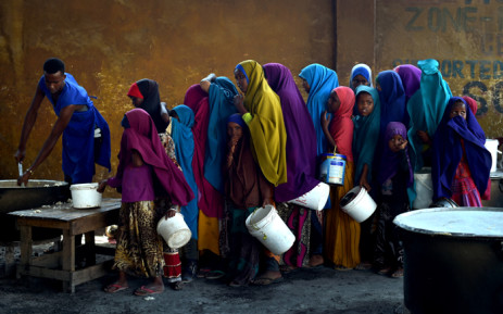 FILE: A severe drought is threatening famine in Somalia, where the UN estimates 5.5 million people at risk. Young girls line up at a feeding centre in Mogadishu. Picture:  United Nations Photo.