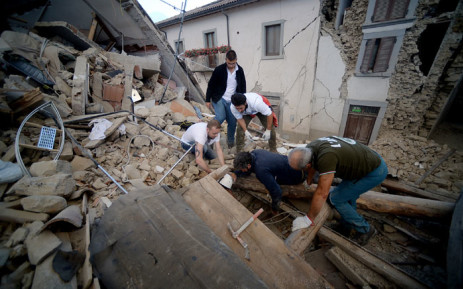 Residents search for victims in the rubble after a strong heartquake hit Amatrice on August 24, 2016. Picture: AFP