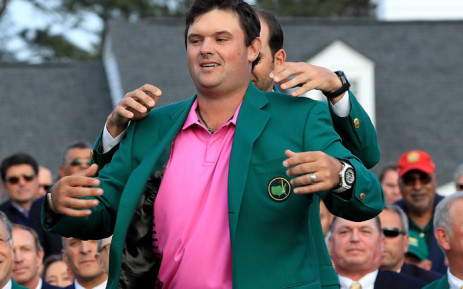 Patrick Reed puts on the Green Jacket after winning the 2018 US Masters at Augusta on 8 April 2018. Picture: AFP