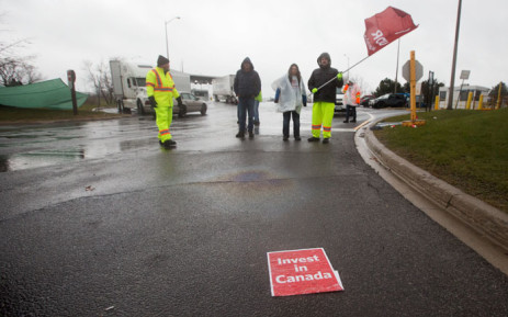 In this file photo taken on 26 November 2018, Unifor union members block a gate 1 at the General Motors Oshawa plant in Oshawa, Ontario.Canada lost 71,000 jobs in November, pushing its unemployment rate up to 5.9%. Picture: AFP