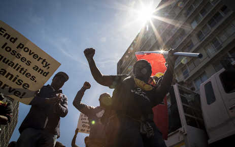 FILE: Members of Cosatu sing and dance in Cape Town's CBD during a march to Parliament where they handed over a list of demands to government. Picture: Thomas Holder/EWN