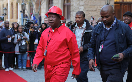 EFF leader Julius Malema wearing the party's signature red overalls. Picture: EWN.