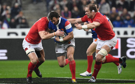 France's full back Maxime Medard (C) is tackled during the Six Nations rugby union tournament match between France and Wales at the stade de France, in Saint Denis, on the outskirts of Paris, on February 1, 2019.