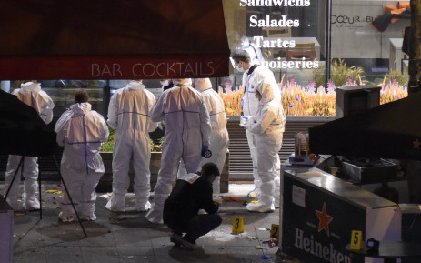 Forensic experts inspect the site of an attack, a restaurant outside the Stade de France stadium in Saint-Denis, north of Paris, early on November 14, 2015, after a series of gun attacks occurred across Paris.  Picture: AFP