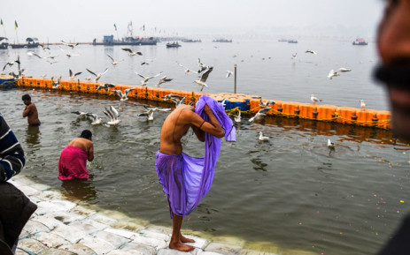 Indian devotees take a dip on the Triveni Sangam banks, the confluence of the Ganges, Yamuna and mythical Saraswati rivers, at the Kumbh Mela festival in Allahabad on 13 January 2019. Picture: AFP
