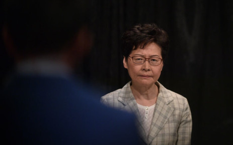 Hong Kong Chief Executive Carrie Lam listens as she takes part in a town hall meeting at Queen Elizabeth Stadium in the Wanchai district of Hong Kong on 26 September 2019, with some 150 people picked via lottery after more than 20,000 people applied to attend the event. Picture: AFP
