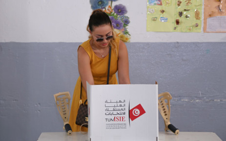 A Tunisian voter casts her ballot for presidential election at a polling station in Sousse, south of the capital Tunis, on 15 September 2019. Picture: AFP