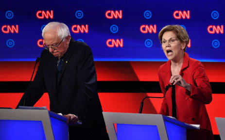 FILE: Democratic presidential hopeful US Senator from Massachusetts Elizabeth Warren (R) delivers her closing statement next to US senator from Vermont Bernie Sanders during the first round of the second Democratic primary debate of the 2020 presidential campaign season hosted by CNN at the Fox Theatre in Detroit, Michigan on 30 July 2019. Picture: AFP.
