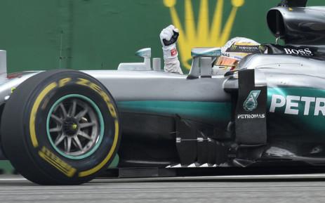 FILE: Mercedes AMG Petronas F1 Team's British driver Lewis Hamilton celebrates a victory. Picture: AFP