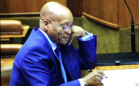 President Jacob Zuma smiles at Mmusi Maimane's accusations at Sona debate. Picture: Thomas Holder/EWN.