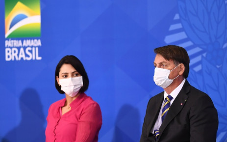 FILE: Brazilian President Jair Bolsonaro and the first lady Michelle Bolsonaro attend the launch of the Rural Women's Rights program at Planalto Palace in Brasilia, on 29 July 2020. This is the first public appearance of Bolsonaro in an official event after he tested negative for COVID-19 coronavirus. Picture: AFP.