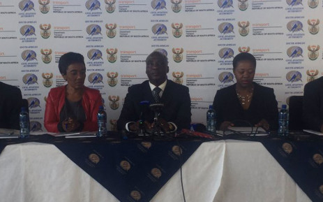 Transport Minster Joe Maswanganyi (centre) releases the preliminary aviation safety audit results at the OR Tambo International Airport. Picture: Thando Kubheka/EWN