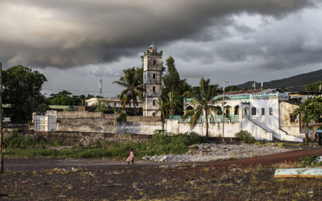 FILE: A Comoran woman walks by the Harbour on 25 March 2019 in Moroni, Comoros. Picture: AFP